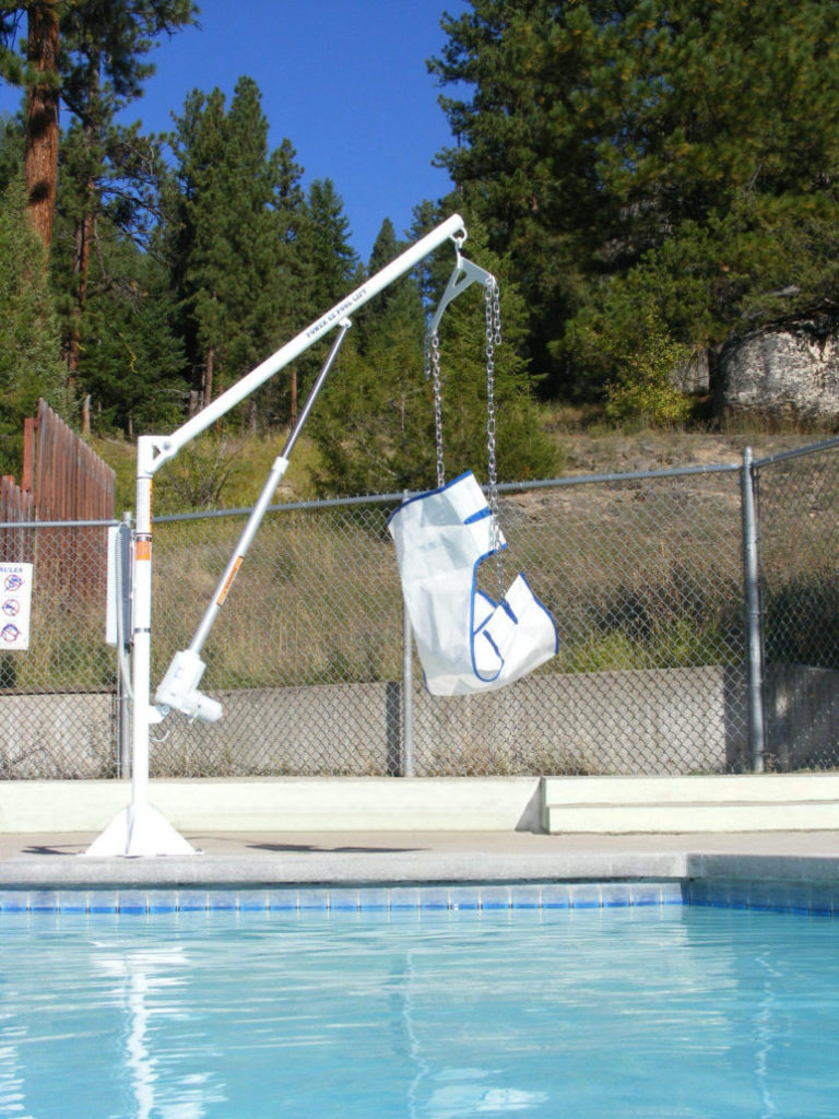 power ez lift show poolside at a distance across the water, with sling seat.