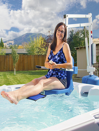 spa ultra lift, shown with user sitting above the hot tub water.