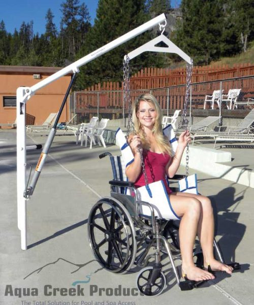 EZ2 pool lift shown next to pool, with sling attachment being used for wheelchair user