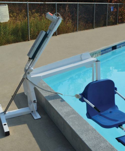 ambassador pool lift, lowered in to a swimming pool, clearing the pool wall