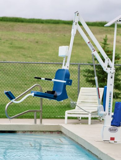 scout excel lift shown set back from the edge of the pool hovering over water, no user.